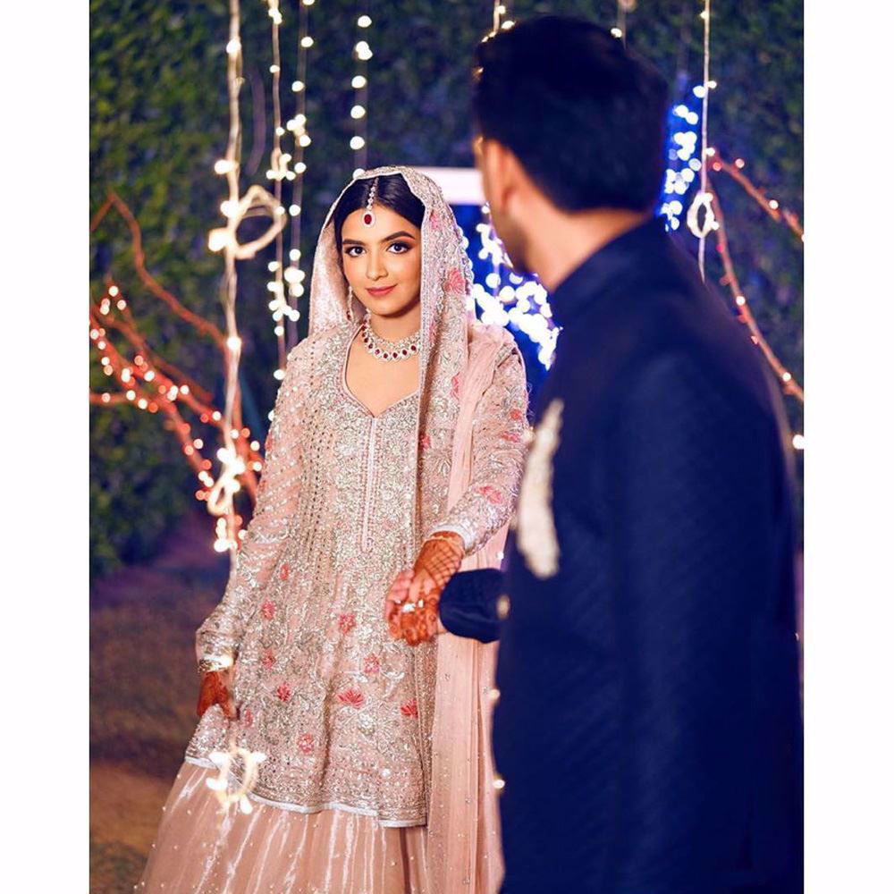 Picture of A breathtaking bride on her engagement day in a blush Farah Talib Aziz bridal