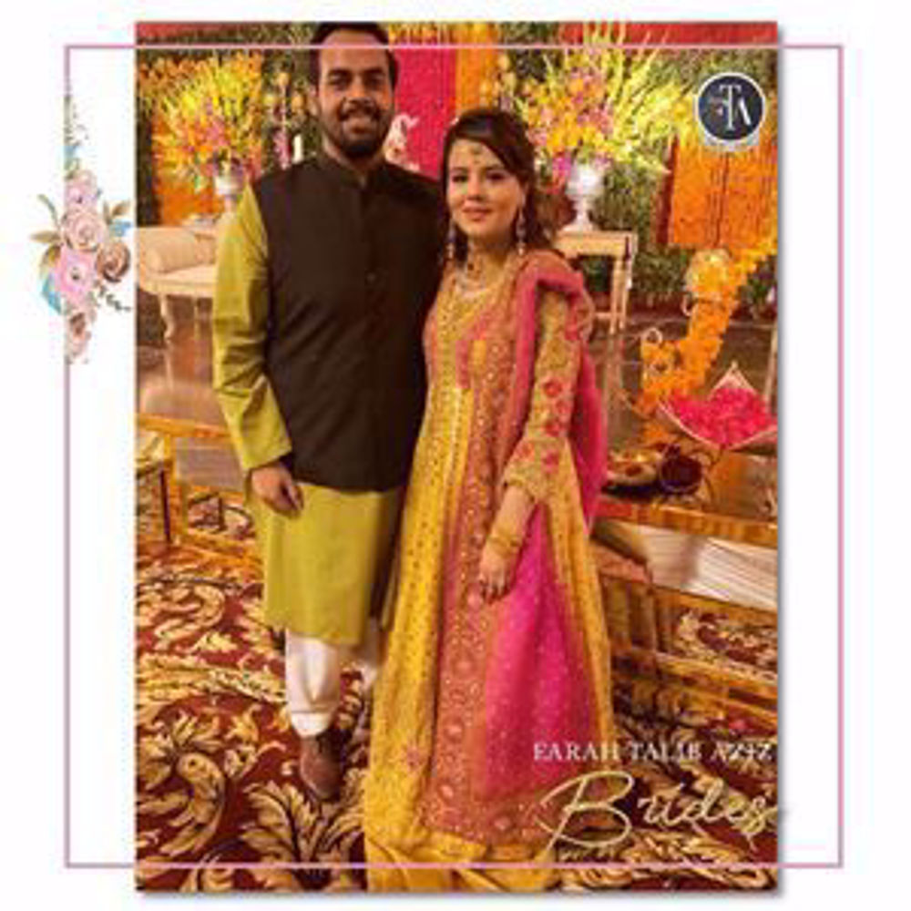 Picture of Beautiful Arooj Shahid uber festive at her wedding festivities in shade of saffron yellow