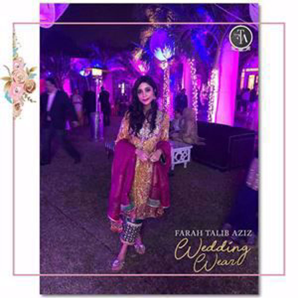 Picture of Beautiful Muzi Sufi glowing in an uber festive Farah Talib Aziz ensemble