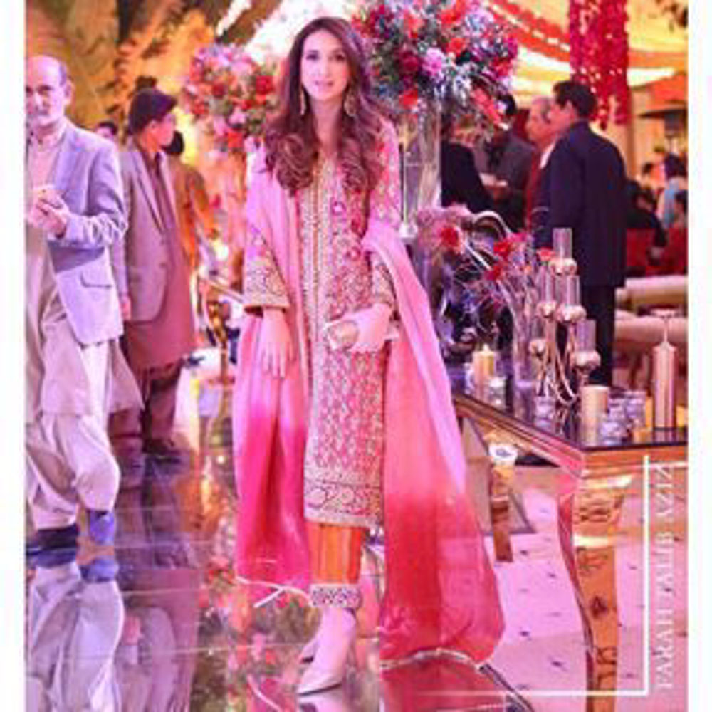 Picture of Gorgeous in signature Farah Talib Aziz shades of melon complemented by burnt orange, magenta and shades of gold embellishments