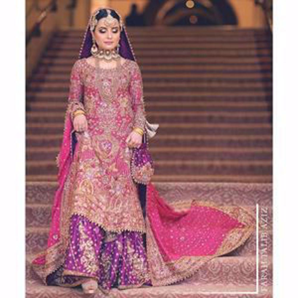 Picture of Hoor, a breathtaking traditional bride on her wedding day in a bougainvillea pink and gold Farah Talib Aziz signature bridal