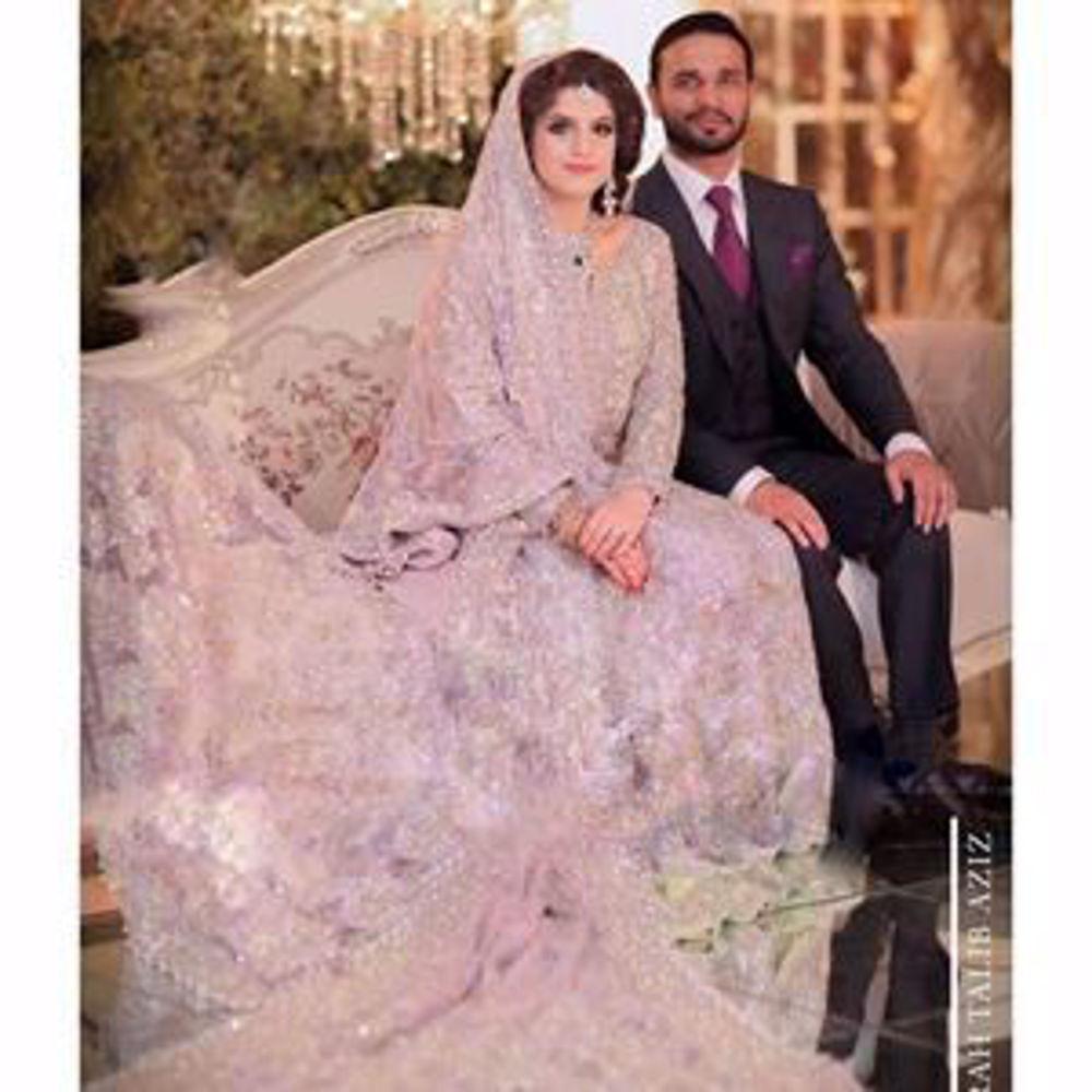 Picture of Kulsoom, a breathtaking bride on her wedding day in a lavender Farah Talib Aziz signature bridal