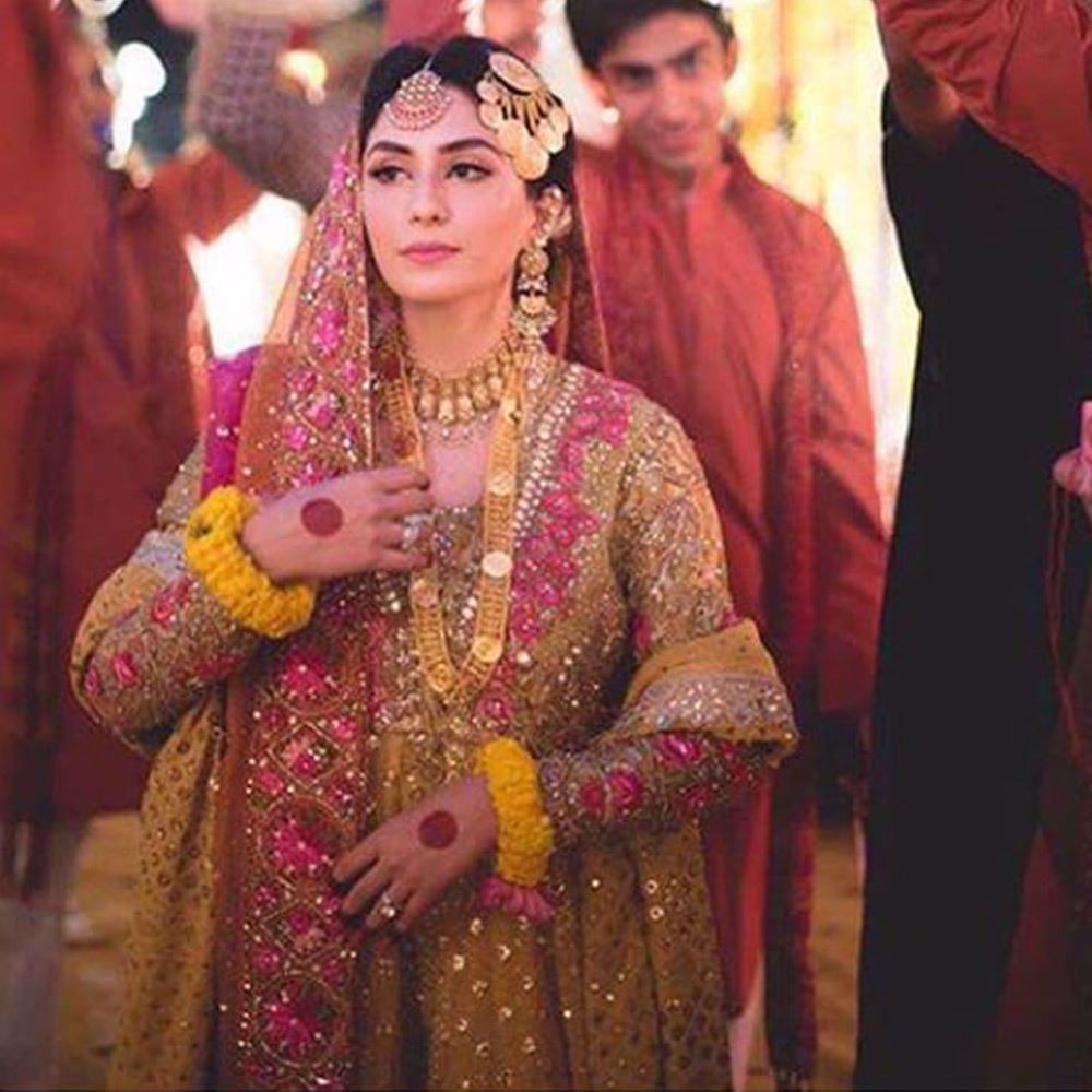 Picture of Absolutely beautiful Anushey in a saffron yellow and bougainvillea pink kalidaar Farah Talib Aziz Peshawas