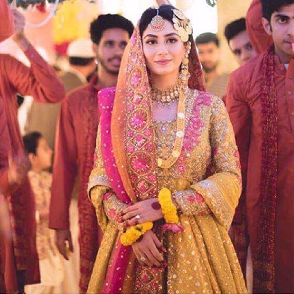 Picture of Absolutely beautiful Anushey in a saffron yellow and bougainvillea pink kalidaar Farah Talib Aziz Peshawas (2)