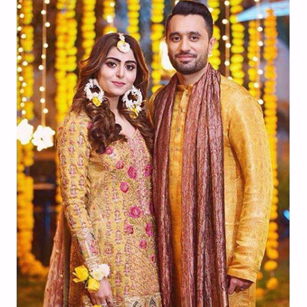 Picture of Sara in a saffron yellow kalidaar paired with a mint gharara