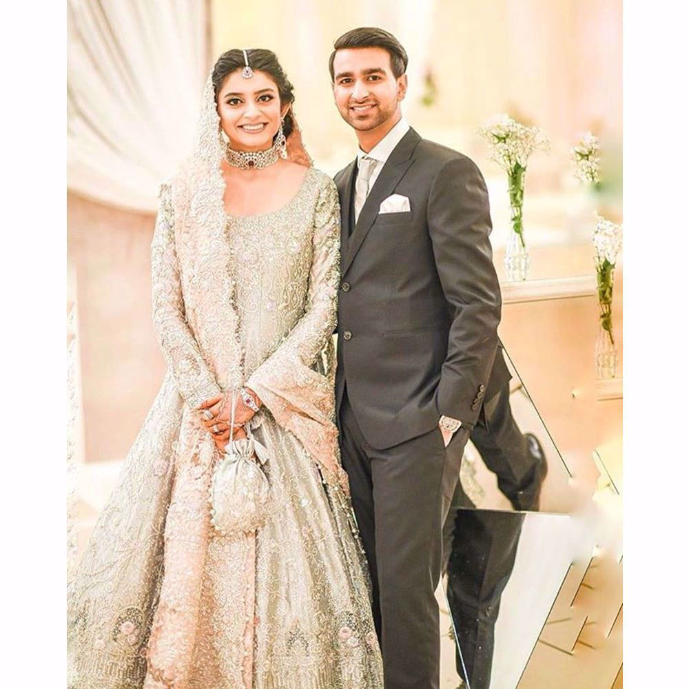 Picture of Mariam on her wedding reception in an aqua and blush pink Farah Talib Aziz bridal