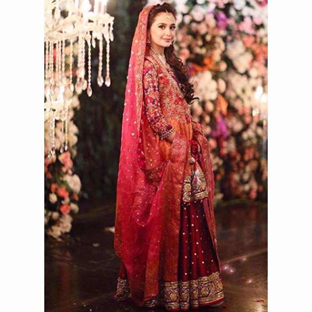 Picture of Absolutely gorgeous in a kalidaar Farah Talib Aziz angarkha in regal shades of burnt orange and magenta pink
