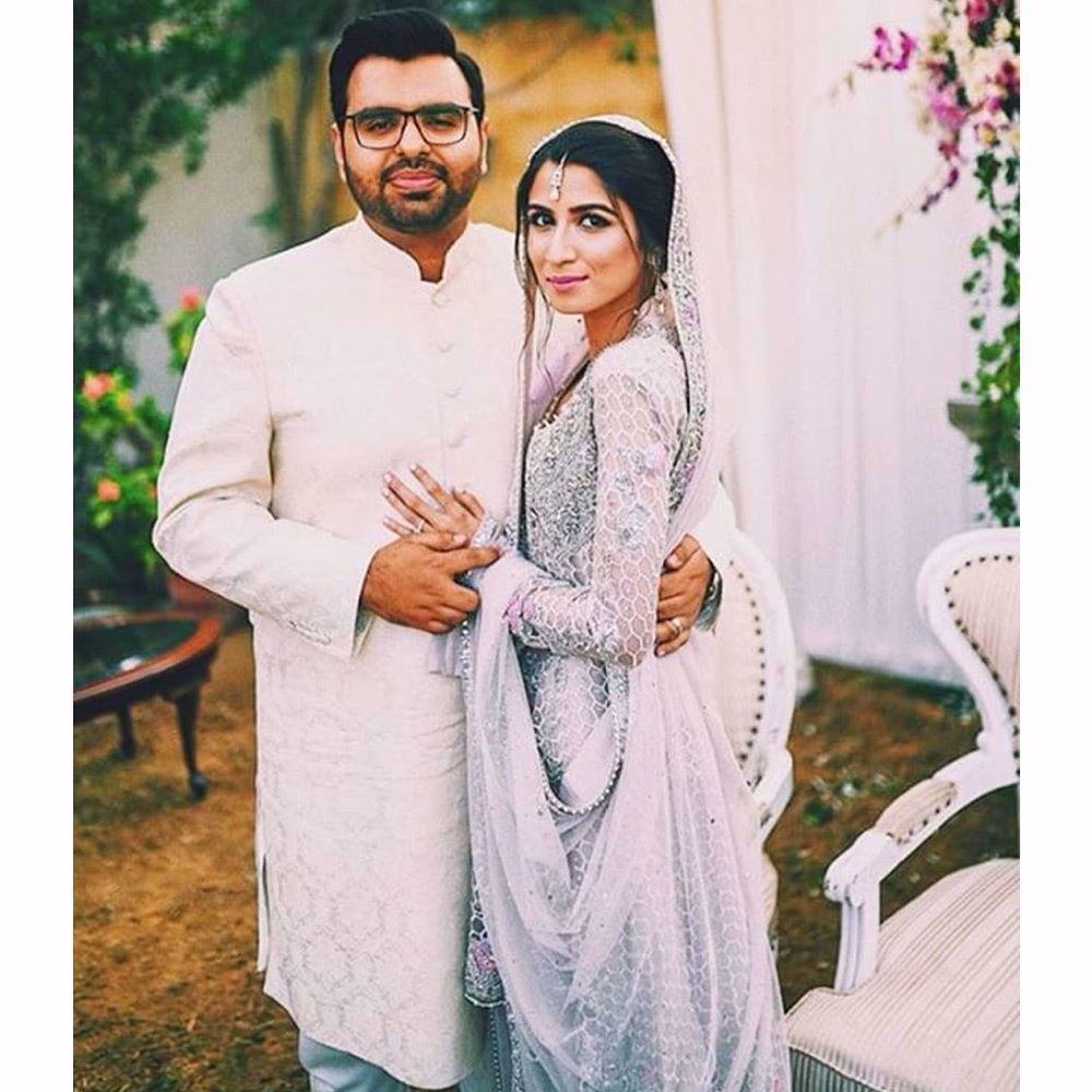 Picture of Aisha made a beautiful bride in a lavender Farah Talib Aziz Bridal