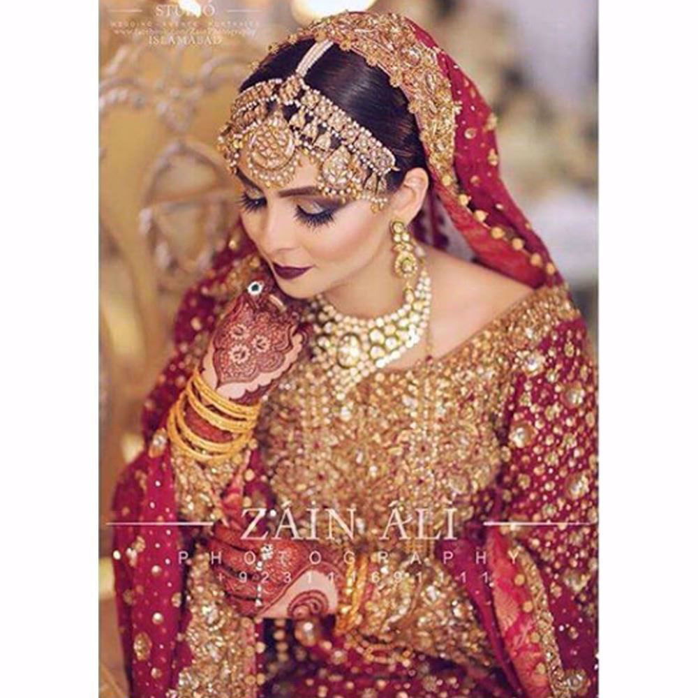 Picture of Aminah, a vision in traditional reds and glistening golds
