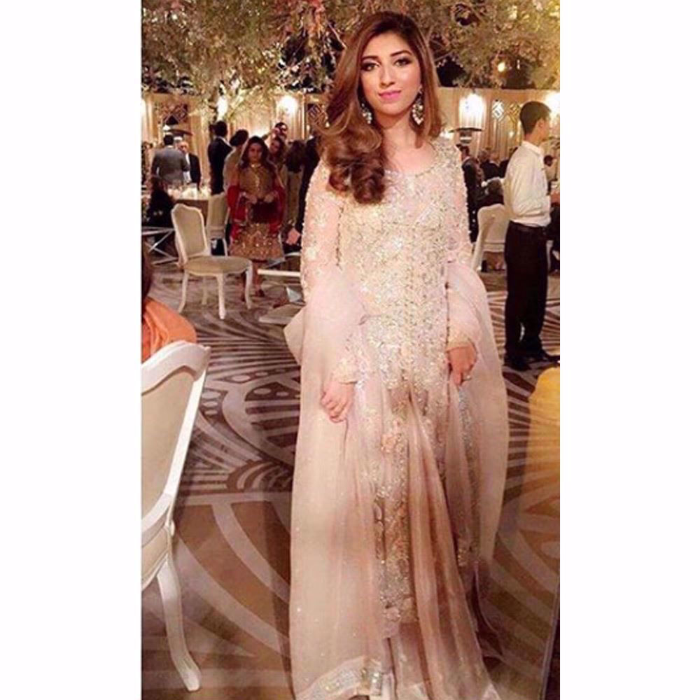 Picture of Maham Baig looking ethereal in a rose pink Farah Talib Aziz ensemble