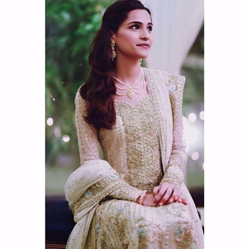 Picture of Neha Patel, absolutely gorgeous on her Nikkah in a custom made Farah Talib Aziz kalidaar peshwas in Ivory featuring gold embellishments