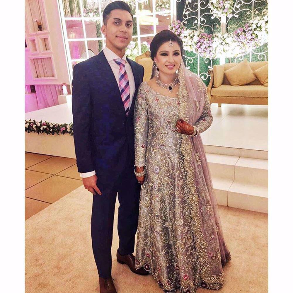 Picture of Bushra in an ice blue Farah Talib Aziz bridal featuring a filigree of silver and Swarovski embellishments