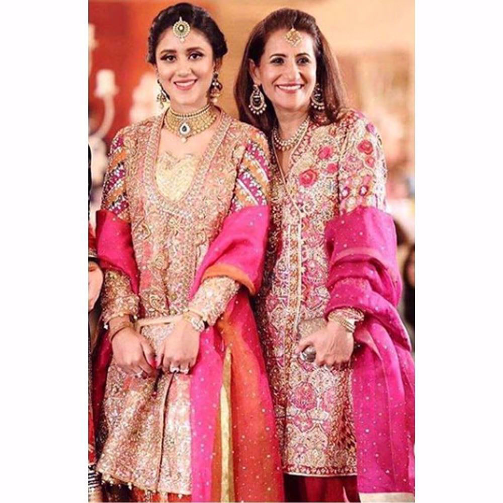 Picture of We love how festive the mother daughter duo look wearing Farah Talib Aziz ensembles