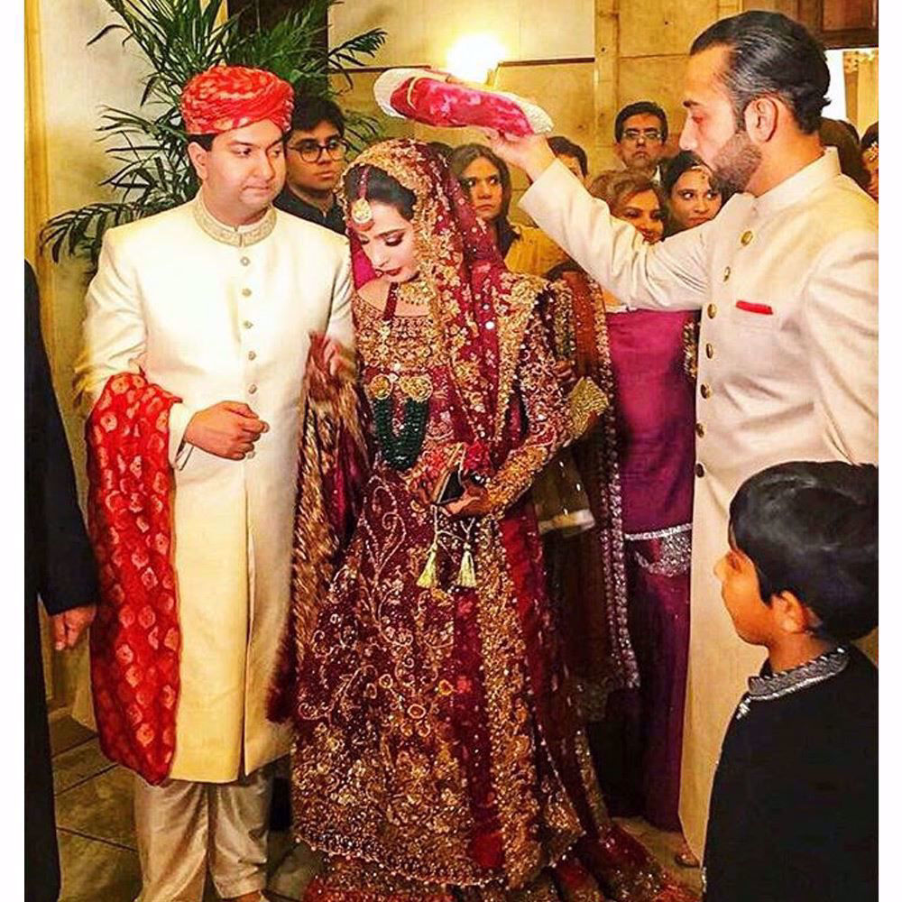 Picture of Soha Safdar looked absolutely regal in a Farah Talib Aziz scarlet red bridal featuring traditional shades of gold embellishments