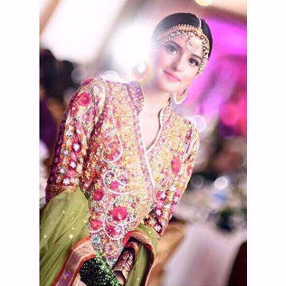 Picture of We love how gorgeous Anna looks in a classic Farah Talib Aziz angarkha in festive shades of pinks