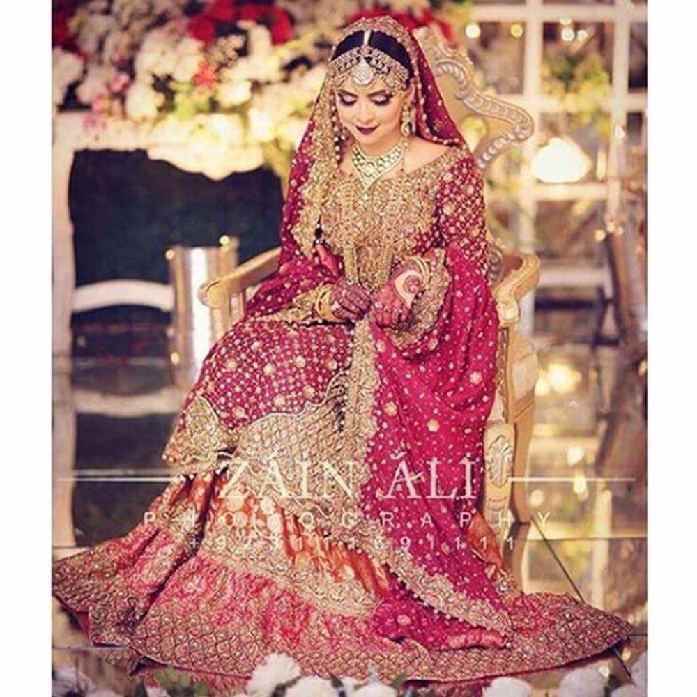 Picture of Aminah, a vision in traditional reds and glistening golds (3)