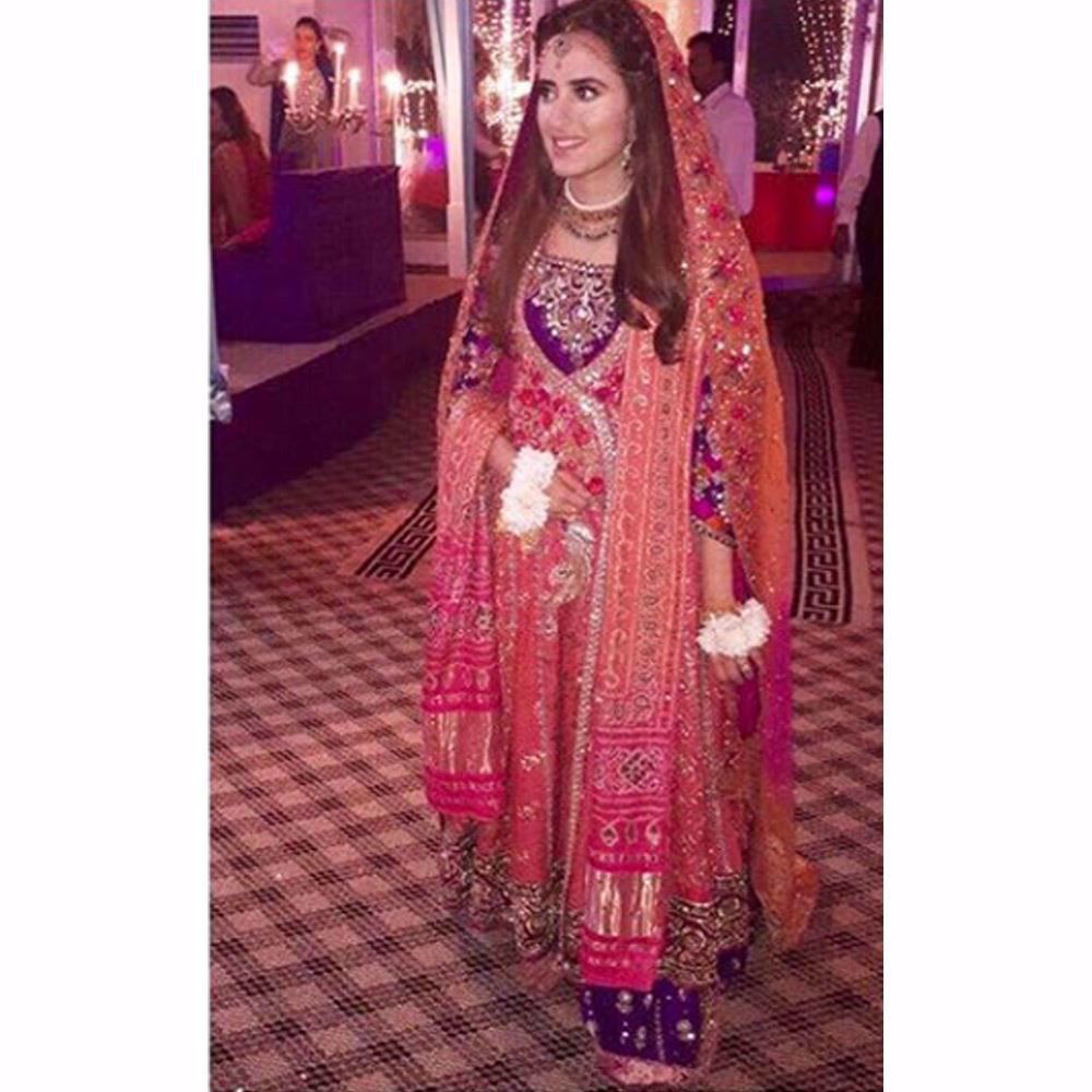 Picture of An absolutely breathtaking traditional Mehndi bride by Farah Talib Aziz in shades of burnt orange, magenta pinks and aubergine