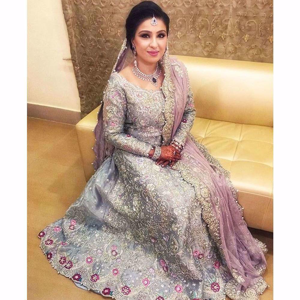 Picture of Bushra in an ice blue Farah Talib Aziz bridal featuring a filigree of silver and Swarovski embellishments (3)