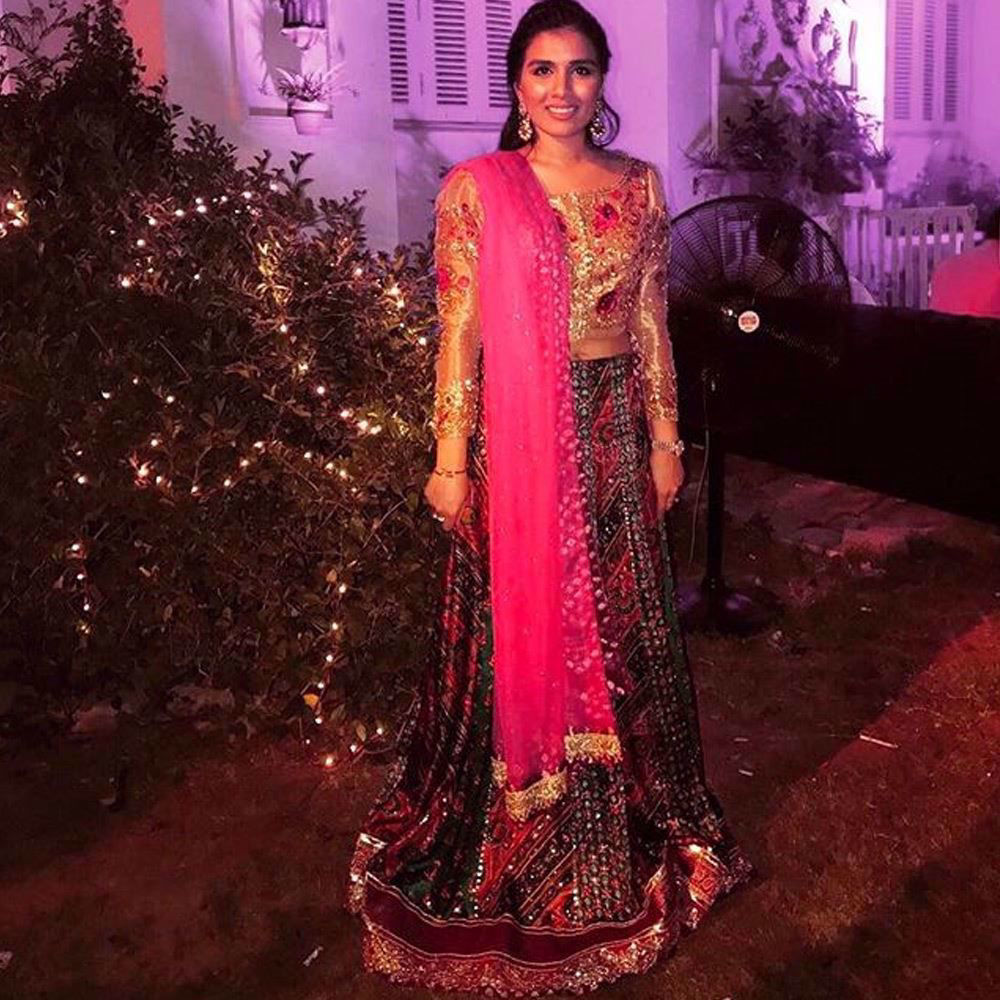 Picture of Shumaila Assad looking uber festive in a shimmering bronze-gold Farah Talib Aziz choli and emerald lengha
