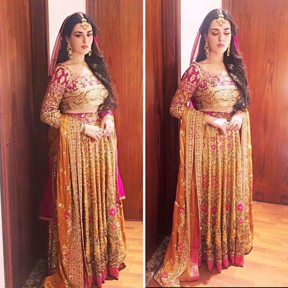 Picture of Our favourite beauty and Make-up sensation Natasha Khalid in a custom made Farah Talib Aziz lengha choli!