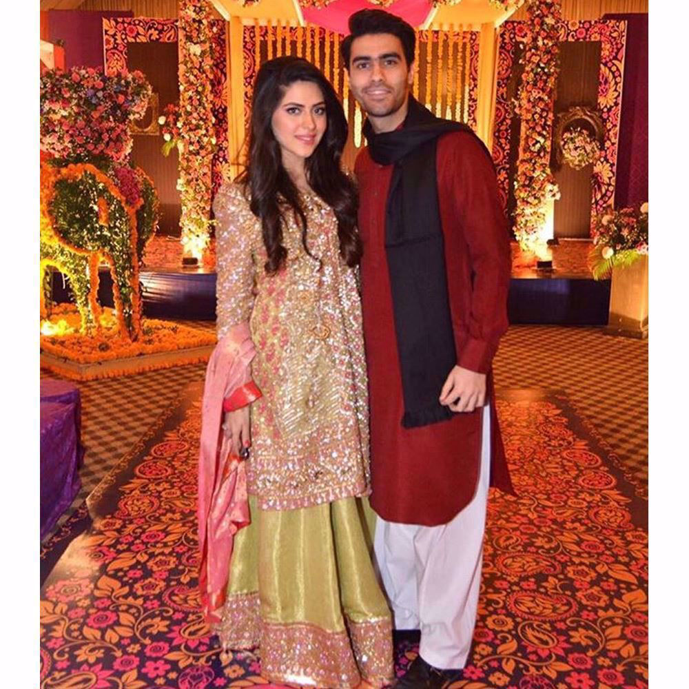 Picture of Maham sparkling in a custom made kiwi green and candy pink Farah Talib Aziz ensemble