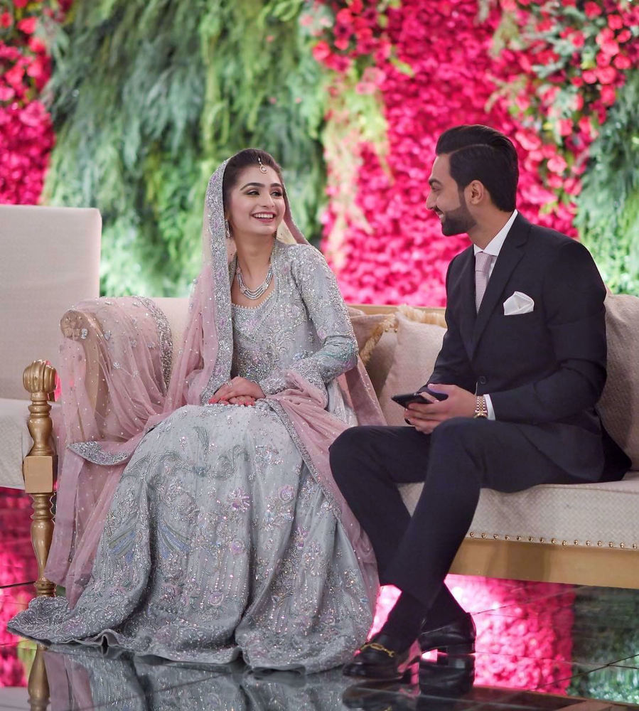 Picture of Sanila Arsal looking utterly mesmerising at her walima in this intricately hand-crafted silver ensemble brought to life with shades of lilac and blush pink