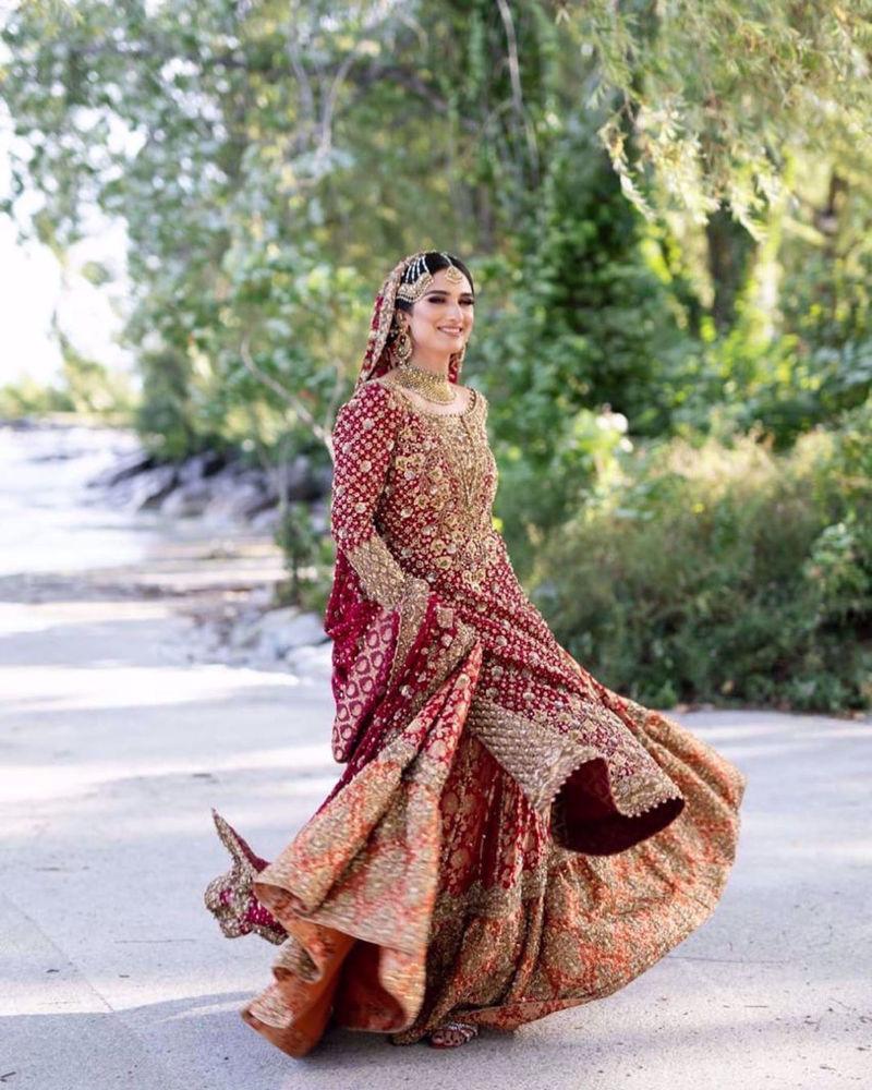 Picture of Saliha Ayub, gorgeous in a traditional scarlet red #Farah Talib Aziz bridal