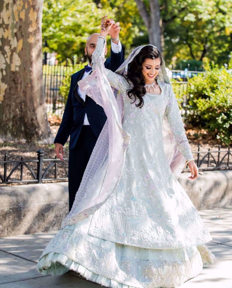 Picture of Nissa Chaudhry ravishing at her wedding, in ice-cool shades of pale blue and lavender, accentuated with silver embellishments and silk thread work