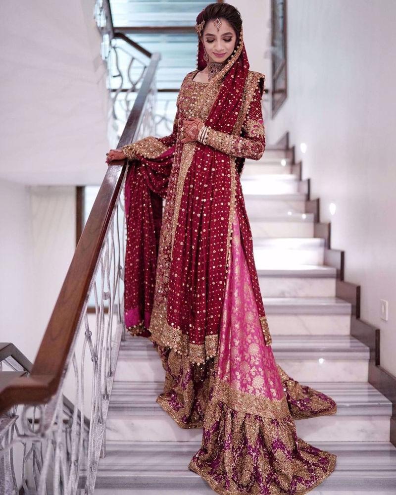 Picture of Hadia Ibrahim Ahmedani, breathtaking at her wedding in a traditional #Farah Talib Aziz scarlett red ensemble