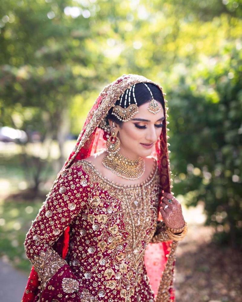 Picture of Saliha Ayub, gorgeous in a stunning scarlet #FarahTalibAziz ensemble accentuated with intricate zardozi and aari embellishments