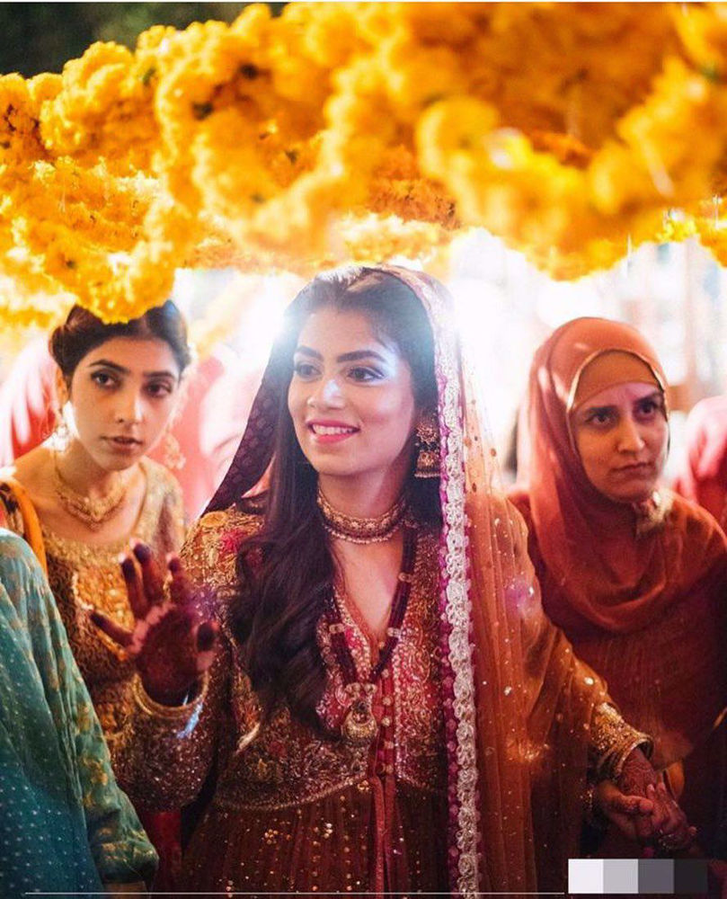Picture of Farah Talib Aziz gives us a lesson in glamour. The bride wears a signature #FarahTalibAziz kalidaar in the perfectly festive colours