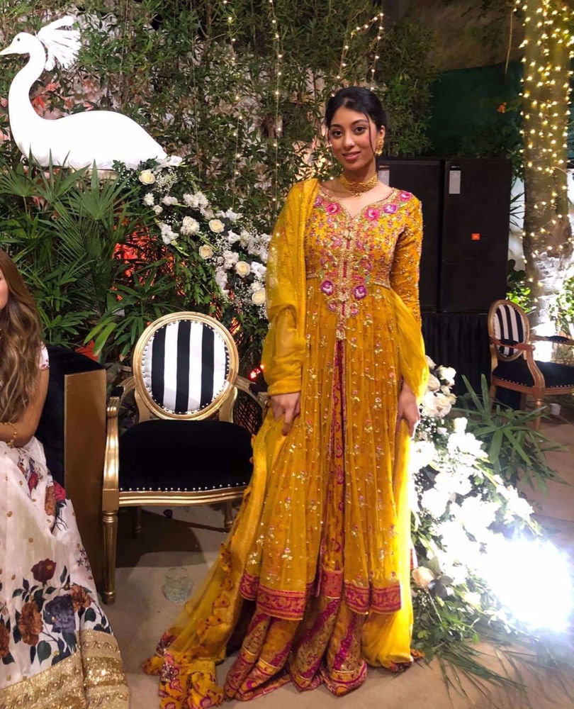 Picture of Toronto based influencer Sofia explores karachi weddings at #chinbad, in a stunning saffron kalidaar accentuated with magenta and gold details