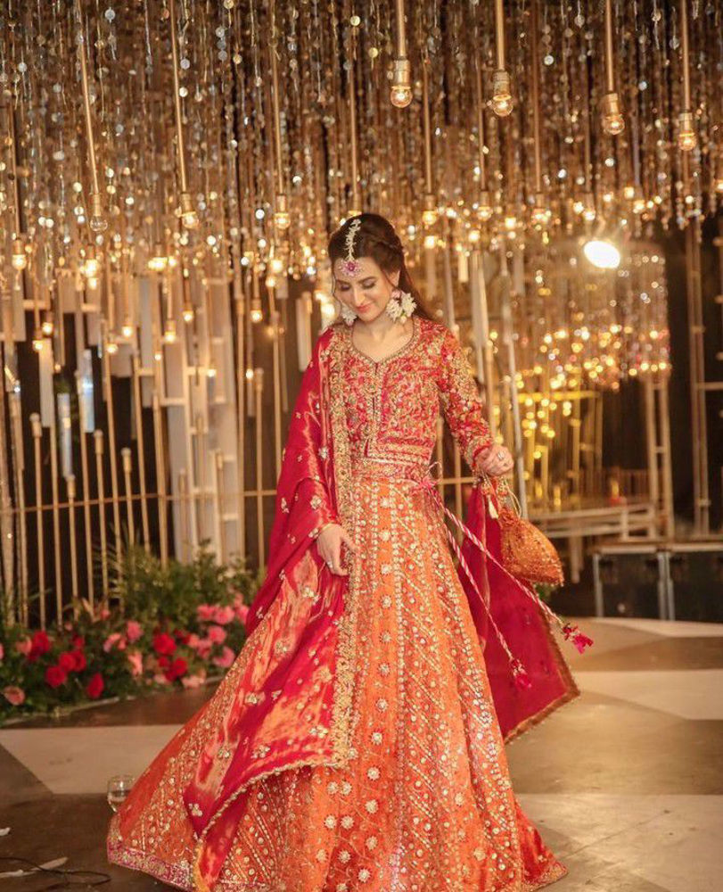 Picture of Marwa makes an absolutely striking bride in a custom #FarahTalibAziz lehnga choli. Bright, uplifting hues, intricate embroideries and yards of fine fabrics create a truly memorable look