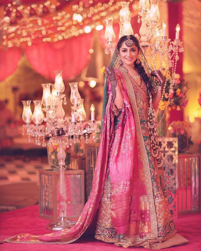Picture of Mariam Abbas personifies glamour at her mehndi. The gorgeous bride wears a signature #FarahTalibAziz ensemble paired with a chunri chaddar in rich colours to create a breath-taking bridal look