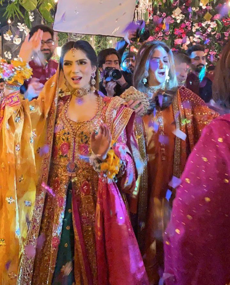 Picture of Kinza is the picture of a glowing bride in a traditonal #FarahTalibAziz ensemble