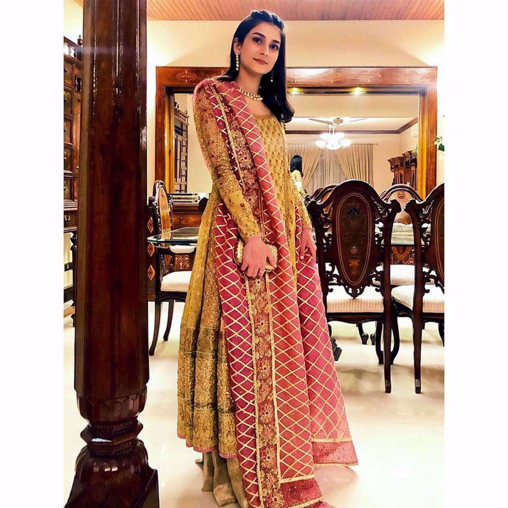 Picture of Alishay Adnan looks perfectly polished in a timeless #FarahTalibAziz kalidaar with a gorgeous gota embellished dupatta
