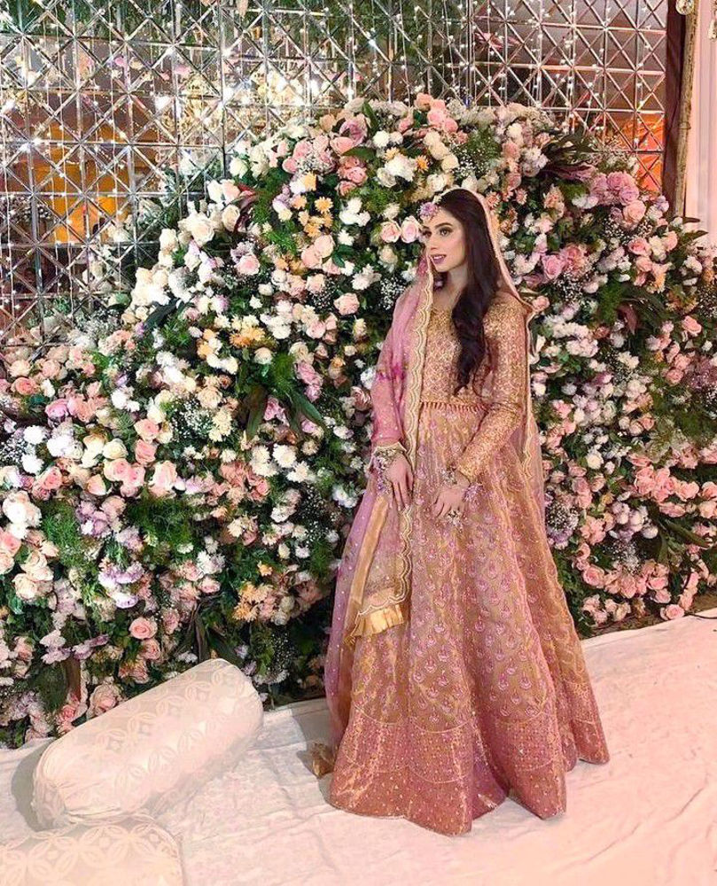 Picture of Alina Malik, breathtaking at her milad in a signature #FarahTalibAziz lehnga choli. Rose gold featuring a tulle florette dupatta to add the perfect flair