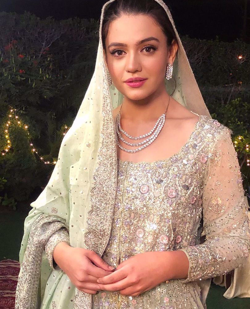 Picture of The gorgeous #ZaraNoorAbbas adds a bit of sparkle to our day in this intricately embellished, pale aqua #FarahTalibAziz kalidaar, thats perfect to make you the bride you want to be