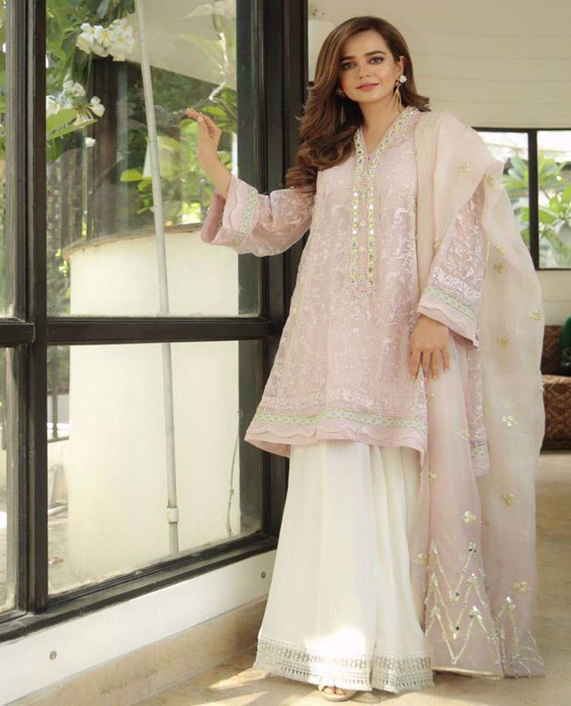 Picture of #SumbulIqbal beautiful in our Mauve Sheesh kurta. Just the perfect amount of delicate sheesha embroidery layered over a delicate floral tapestry make this ensemble truly irresistible!
