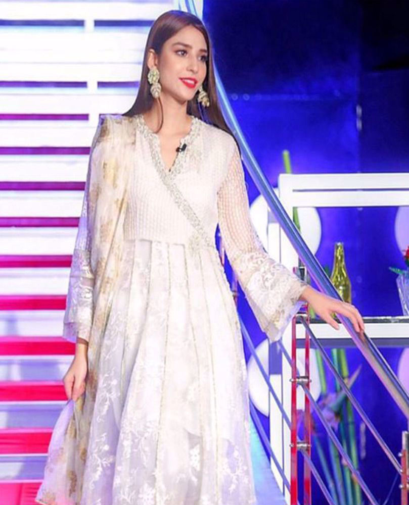 Picture of #RamshaKhan giving life to our day in an ivory hand embellished #FarahTalibAziz luxe Pret outfit that's perfect to brighten your Ramadan and Eid celebrations