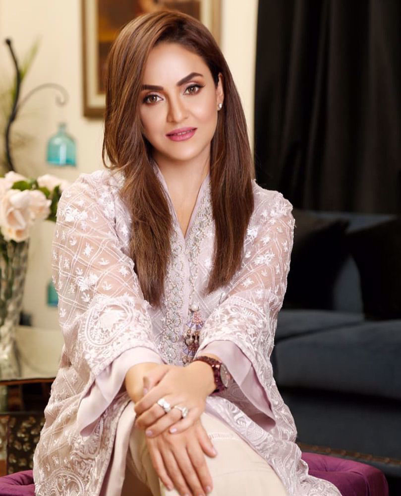 Picture of #NadiaKhan giving life to our day in a pale pink hand embellished #FarahTalibAziz luxe Pret outfit that's perfect to brighten your Ramadan and Eid celebrations