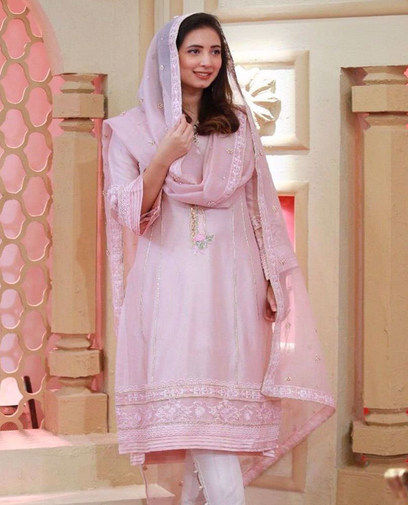 Picture of #KomalAzizKhan giving us major style goals in a chai pink hand embellished #FarahTalibAziz luxe Pret outfit, that's perfect to add some sparkle your Ramadan and Eid celebrations.