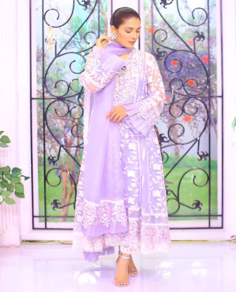 Picture of #AyezaKhan giving life to our day in an powder blue hand embellished #FarahTalibAziz luxe Pret outfit that's perfect to brighten your Ramadan and Eid celebrations 
