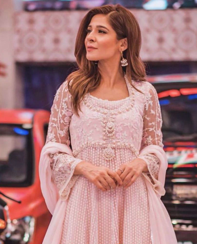 Picture of #AyeshaOmar giving life to our day in a pearl pink hand embellished #FarahTalibAziz luxe Pret outfit that's perfect to brighten your Ramadan and Eid celebrations