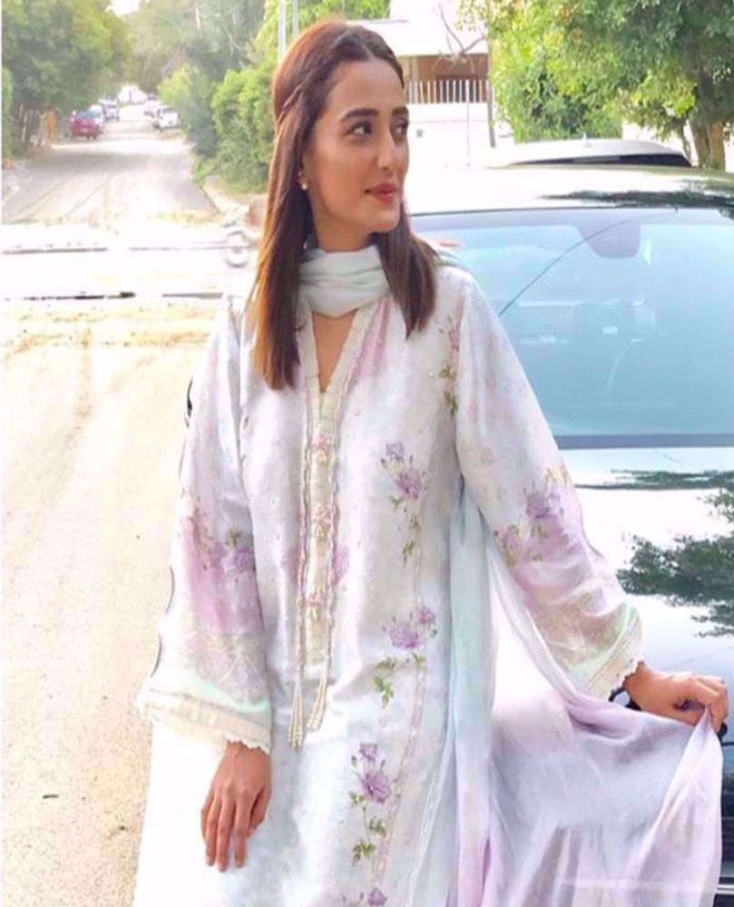 Picture of #MomalSheikh beautiful wearing one of our favourite aqua Luxe Pret looks from the latest #FarahTalibAziz Eid collection #Suri this Eid ✨