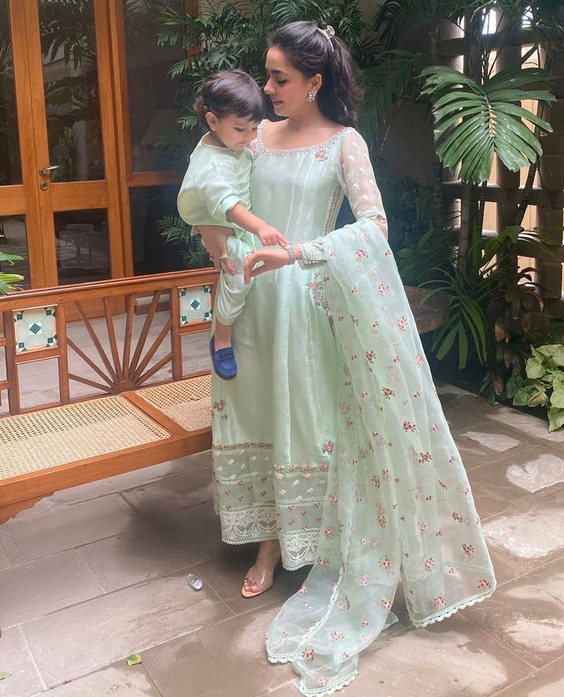 Picture of Our very own, the fabulous Maliha Aziz Jamil in a cool mint green #FarahTalibAziz ensemble.