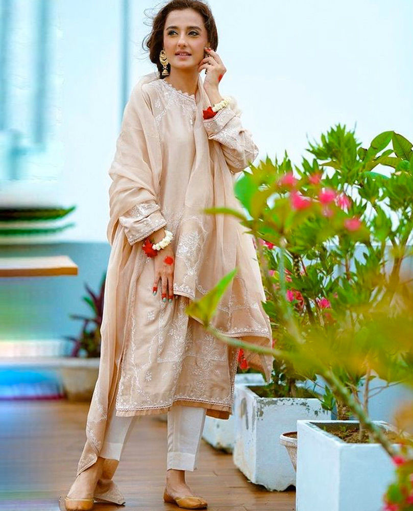 Picture of Perfecting the traditional Eid look, #MomalSheikh celebrates in our intricately embroidered Beige Emma Kurta Shalwar.